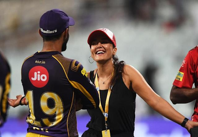 "Indian actress and Kings XI Punjab co-owner Preity Zinta talks with Kolkata Knight Riders captain Dinesh Karthik after a game. The IPL has been dubbed a ""perfect storm with elements of the Champions League, pro wrestling and a touch of Bollywood"" (AFP Photo/Dibyangshu SARKAR)"