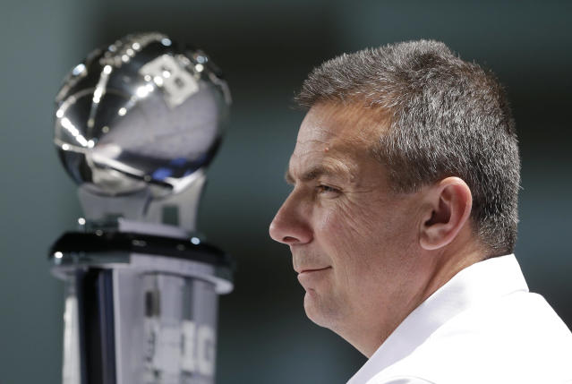 Ohio State head coach Urban Meyer listens to a question during a news conference for the Big Ten Conference championship NCAA college football game on Friday, Dec. 6, 2013, in Indianapolis. Ohio State is to play Michigan State, Saturday for the championship. (AP Photo/Darron Cummings)