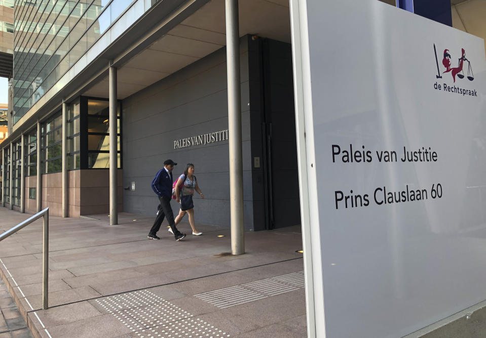 The outside of the court, at the start of the court case for on a 74-year-old woman suffering from dementia who was euthanized three years ago despite some indications that she might have changed her mind, as the trial opens in The Hague, Netherlands, Monday Aug. 26, 2019. The landmark euthanasia trial seeks to pinpoint what to do with dementia patients who have previously stated their wish to die under certain circumstances but later might have second thoughts. (AP Photo/Aleks Furtula)