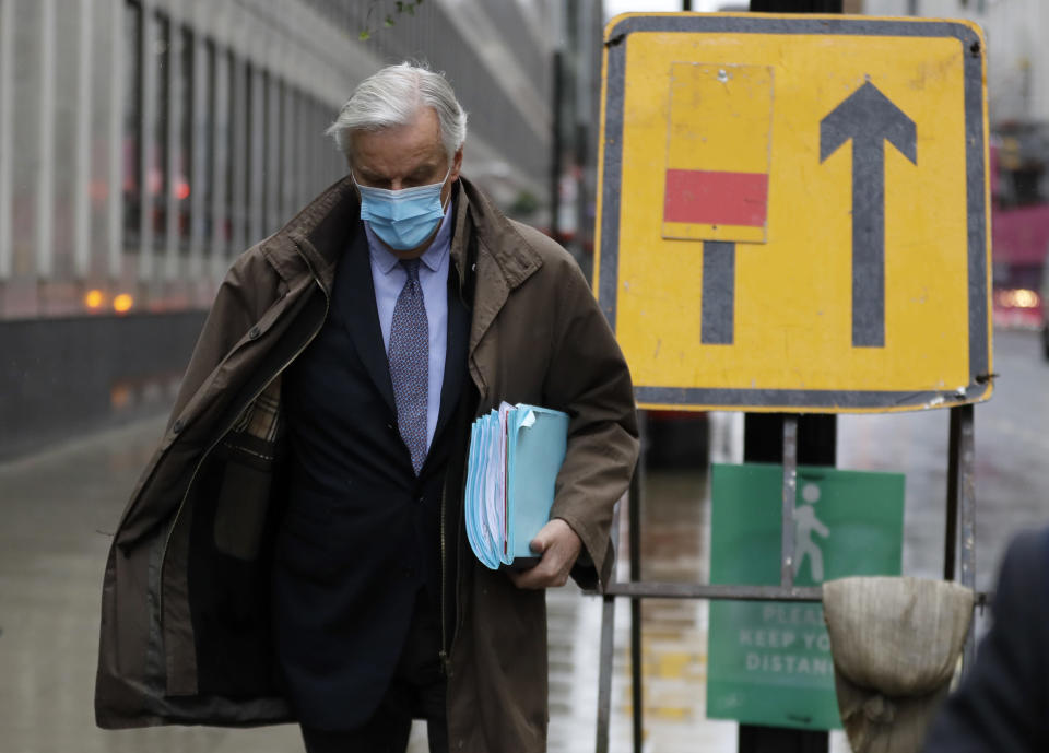 European Union chief Brexit negotiator Michel Barnier walks to the Conference Centre in London, Thursday, Dec. 3, 2020. With less than one month to go before the U.K. exits the EU's economic orbit, talks are continuing, and U.K. officials have said this is the last week to strike a deal. (AP Photo/Kirsty Wigglesworth)