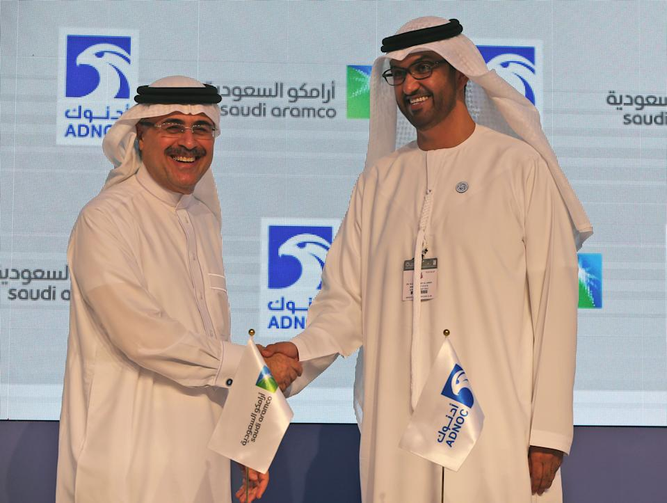 Saudi Aramco President Amin al-Nasser, left, shakes hands with Sultan Ahmed Al Jaber, UAE Minister of State and ADNOC Group CEO after they signed a contract in the opening day of the Abu Dhabi International Exhibition & Conference, ADIPEC, in Abu Dhabi, United Arab Emirates, Monday, Nov. 12, 2018. OPEC and allied oil-producing countries likely need to cut crude supplies to rebalance the market after proposed U.S. sanctions on Iran failed to cut Tehran's ouput, top Saudi and Emirati energy officials said Monday. (AP Photo/Kamran Jebreili)