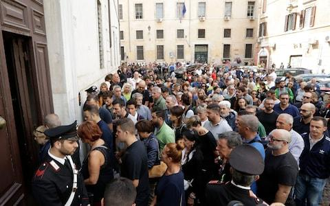<span>People arrive to pay respect in the church where Carabinieri officer Mario Cerciello Rega was laid in state, in Rome, Sunday, July 28, 2019</span> <span>Credit: AP </span>