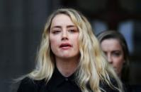 BRITAIN-PEOPLE-DEPPActors Johnny Depp and Amber Heard at the High Court in London