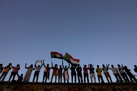 FILE PHOTO: Sudanese protesters attend a demonstration in front of the defense ministry compound in Khartoum