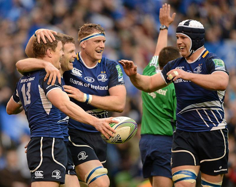 7 April 2012; Brian O'Driscoll, Leinster, is congratulated by team mates Gordon D'Arcy, Jamie Heaslip, centre, and Sean O'Brien, right, after scoring his side's third try. Heineken Cup Quarter-Final, Leinster v Cardiff Blues, Aviva Stadium, Lansdowne Road, Dublin. Picture credit: Matt Browne / SPORTSFILE (Photo by Sportsfile/Corbis/Sportsfile via Getty Images)