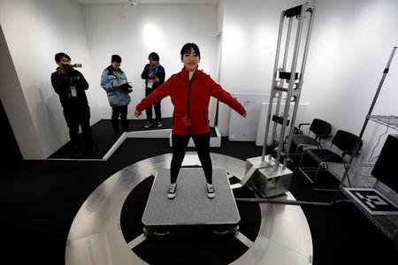 A visitor is scanned to add her images to an animation during the Tokyo 2020 Japan House media preview in Gangneung, South Korea, February 8, 2018. REUTERS/Jorge Silva