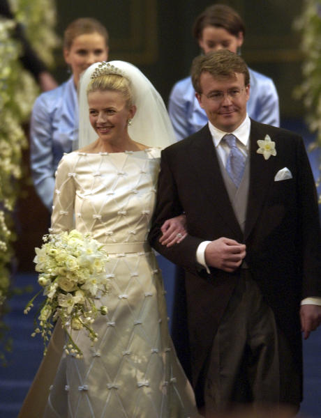 """FILE - In this April 24, 2004 file photo Dutch Prince Johan Friso, second son of Queen Beatrix, right, and Mabel Wisse Smit enter the church before exchanging wedding vows at the Oude Kerk, or Old Church, in Delft, Netherlands. The Dutch royal house says in a statement on Monday, Aug. 12, 2013 that Prince Johan Friso, the youngest brother of King Willem-Alexander, has died of complications after the 2012 skiing accident that left him with grave brain damage. In a statement, the royal house said that the 44-year-old Friso had never regained more than """"minimal consciousness"""" after the accident, in which he was buried by an avalanche. He died Monday at the Palace Huis ten Bosch, in The Hague, Netherlands, where he was being cared for. (AP Photo/Dusan Vranic, File)"""
