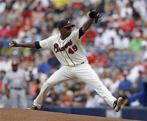 Atlanta Braves starting pitcher Julio Teheran (49) works in the first inning of a baseball game against the Cincinnati Reds, Sunday, July 14, 2013, in Atlanta. (AP Photo/John Bazemore)