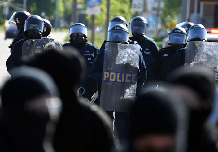 <p>Anti-riot police take positions as protesters march in Quebec City on June 8, 2018, as the G7 Summits gets underway. (Photo: Martin Ouellet-Diotte/AFP/Getty Images) </p>