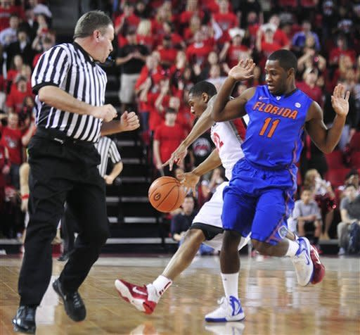 Florida guard Erving Walker (11) pressures Georgia guard Gerald Robinson (22) as he tries to maintain possession of the ball during an NCAA college basketball game, Saturday, Feb. 25, 2012, in Athens, Ga. (AP Photo/The Banner-Herald, Richard Hamm) MAGS OUT; MANDATORY CREDIT; TV OUT