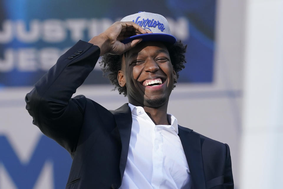 Golden State Warriors draft pick James Wiseman laughs during a news conference.