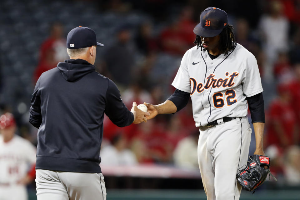 Detroit Tigers starting pitcher Jose Urena, right, gives the ball to manager A.J. Hinch after the Los Angeles Angels had scored five runs during the fifth inning of a baseball game in Anaheim, Calif., Friday, June 18, 2021. (AP Photo/Alex Gallardo)