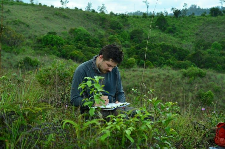Image of the author investigating grass in Sri Lanka.