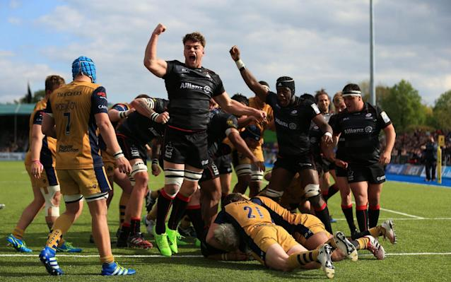 <span>Saracens celebrate scoring a try at Allianz Park on Saturday</span> <span>Credit: Getty Images </span>