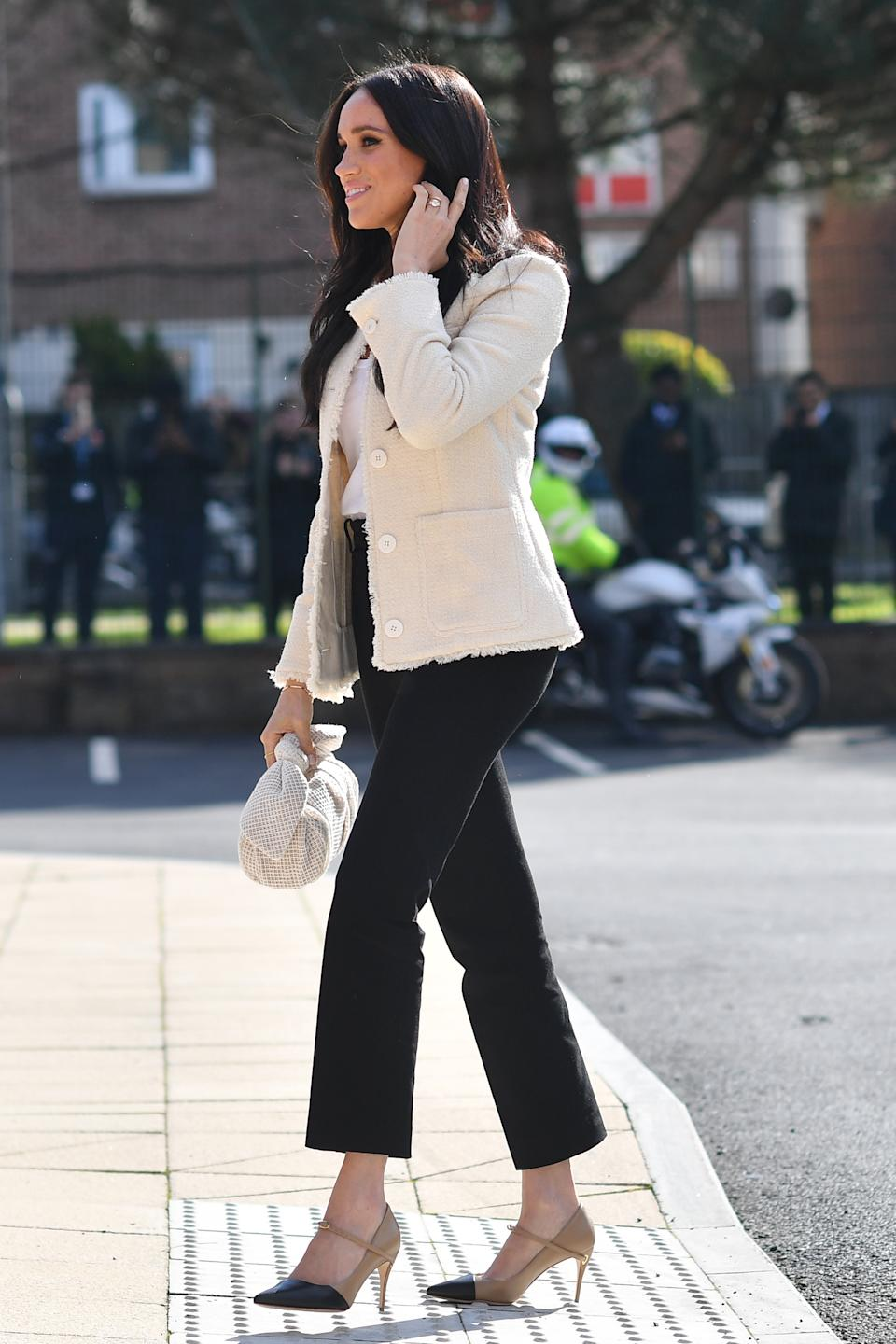 Meghan, Duchess of Sussex, visited the the Robert Clack Upper School in Dagenham to attend a special assembly ahead of International Women's Day in March 6, 2020 in London, England, wearing Me+Em blazer.   (Getty Images)