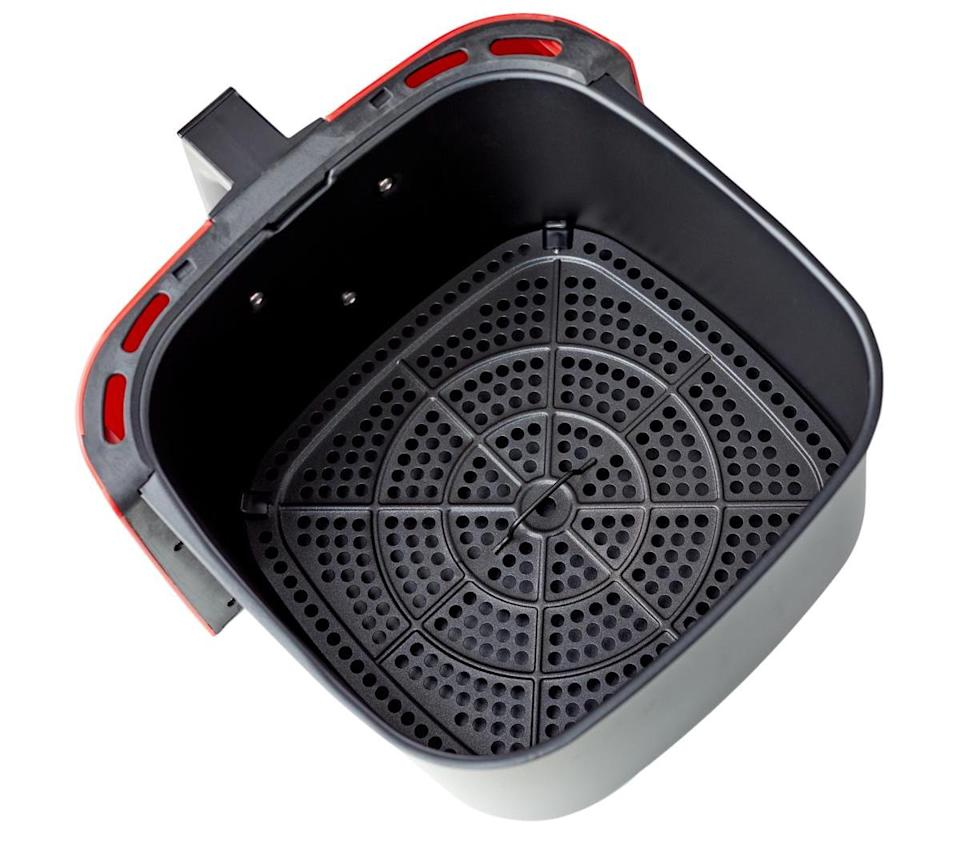 Here's what the inside of the Wolfgang Puck air fryer looks like—a nine-quart basket and nonstick air frying rack. (Photo: HSN)