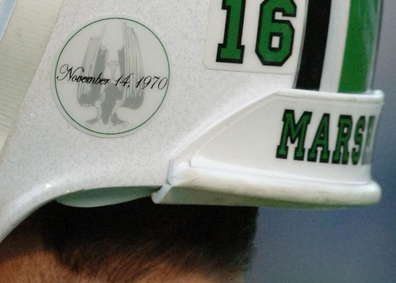 A decal honoring the Memorial Fountain at Marshall University's student center adorns quarterback Jimmy Skinner's helmet Saturday, Nov. 19, 2005, in Huntington, W.Va. This year is the 35th anniversary of the crash of a chartered plane that took the lives of 75 players, coaches, staff members, community supporters and the flight crew returning from Marshall's game at East Carolina. Players are wearing the decals in memory of the lives lost. (AP Photo/Jeff Gentner)
