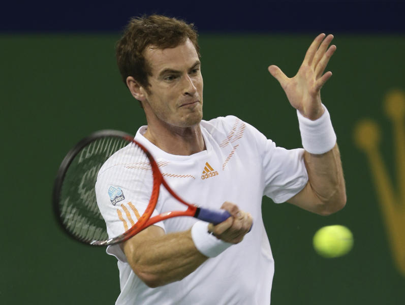Andy Murray of Britain returns a shot to Roger Federer of Switzerland during the men's singles semifinal match at the Shanghai Masters tennis tournament at Qizhong Forest Sports City Tennis Center in Shanghai, China, Saturday Oct. 13, 2012. (AP Photo/Kin Cheung)