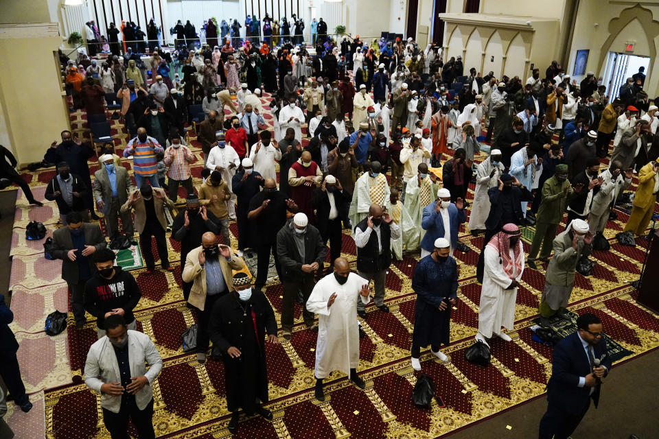 Worshippers perform an Eid al-Fitr prayer at the Masjidullah Mosque in Philadelphia, Thursday, May 13, 2021. Millions of Muslims across the world are marking the holiday of Eid al-Fitr, the end of the fasting month of Ramadan. (AP Photo/Matt Rourke)