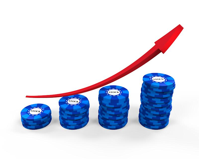 Four increasingly higher stacks of blue chips with a red line trending upwards.