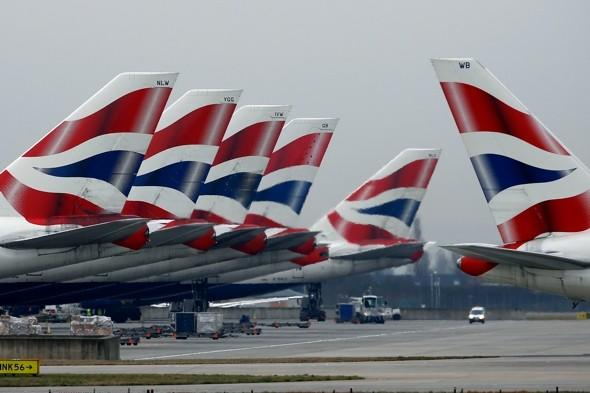 Woman removed from BA plane after 'smuggling' dog on board