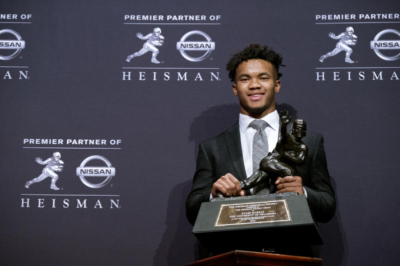 Oklahoma quarterback Kyler Murray holds the Heisman Trophy after winning the award Saturday Dec. 8 2018 in New York. More