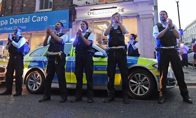 Clapping police officers outside the Chelsea and Westminster Hospital