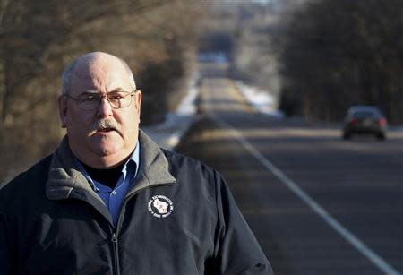 Retired Wisconsin State Trooper Keith Young stands on highway 40 in Elk Mound, Wisconsin March 22, 2014. REUTERS/Andy Clayton-King