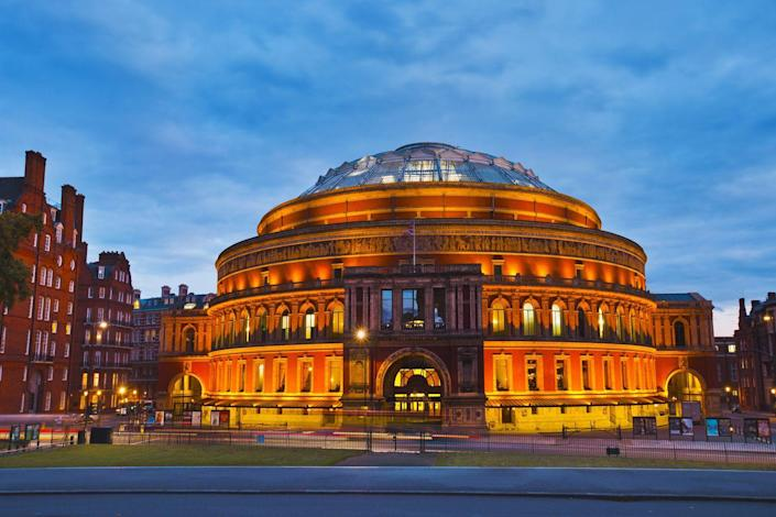 """<p>Since its inauguration in 1871, the <a href=""""https://www.royalalberthall.com/"""" rel=""""nofollow noopener"""" target=""""_blank"""" data-ylk=""""slk:Royal Albert Hall"""" class=""""link rapid-noclick-resp"""">Royal Albert Hall</a> has been the United Kingdom's premiere performance venue, most famously hosting the renowned Proms concerts each year. The idea for the hall stemmed from Prince Albert's 1851 proposal for a series of buildings to be built in Hyde Park to further advance the study of art, science, and industry. </p><p>The Prince Consort died before being able to see his ideas come to life, but Queen Victoria made sure a memorial was built in his name and laid down the foundation stone for the venue in 1867. Built in the Italianate style, Royal Albert Hall features a glazed-iron dome and an 800-foot-long terra-cotta mosaic frieze depicting """"the Triumph of Arts and Sciences.""""</p>"""