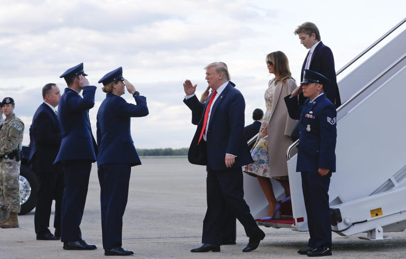 President Donald Trump, center, returns a salute during his arrival on Air Force One with first lady Melania Trump and their son Barron Trump at Andrews Air Force Base, Md., Sunday, April 21 2019. (AP Photo/Pablo Martinez Monsivais)