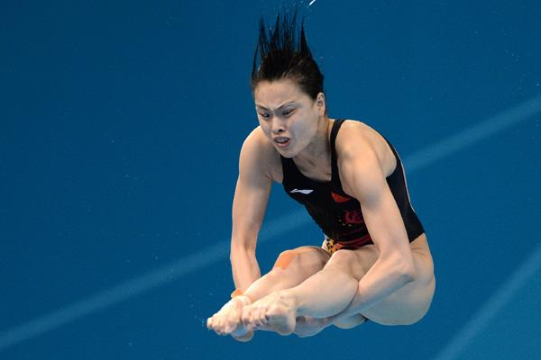 China's Wu Minxia in action during the Women's 3m Springboard Preliminary Round at the Aquatic Centre
