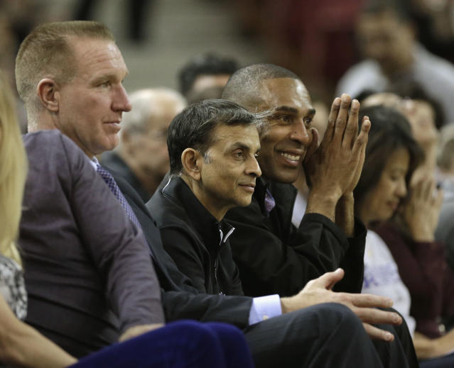 Kings owner Vivek Ranadive, center, watches a game with Chris Mullin, left, and former 49ers back Roger Craig last season. (AP)