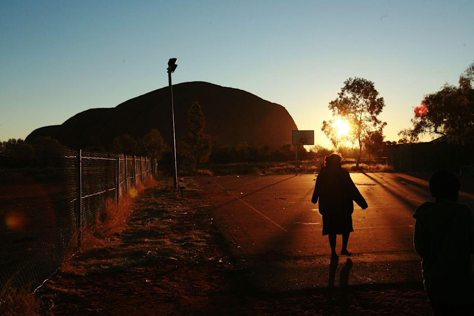 The Aboriginal community of Mutitjulu, in the shadow of Uluru, where the AstraZeneca vaccine will be available at the Mutitjulu Health Service. (Photo: Getty)