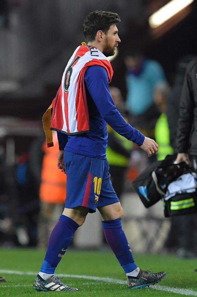 Job done: Lionel Messi leaves the pitch with the shirt of Girona's Alex Granell after Barcelona's 6-1 win