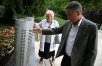 Fikret Grabovica, President of the Association of Parents of Murdered Children, and Zdravka Gvozdjar, mother of a murdered child, touch the monument for children killed during the siege of Sarajevo