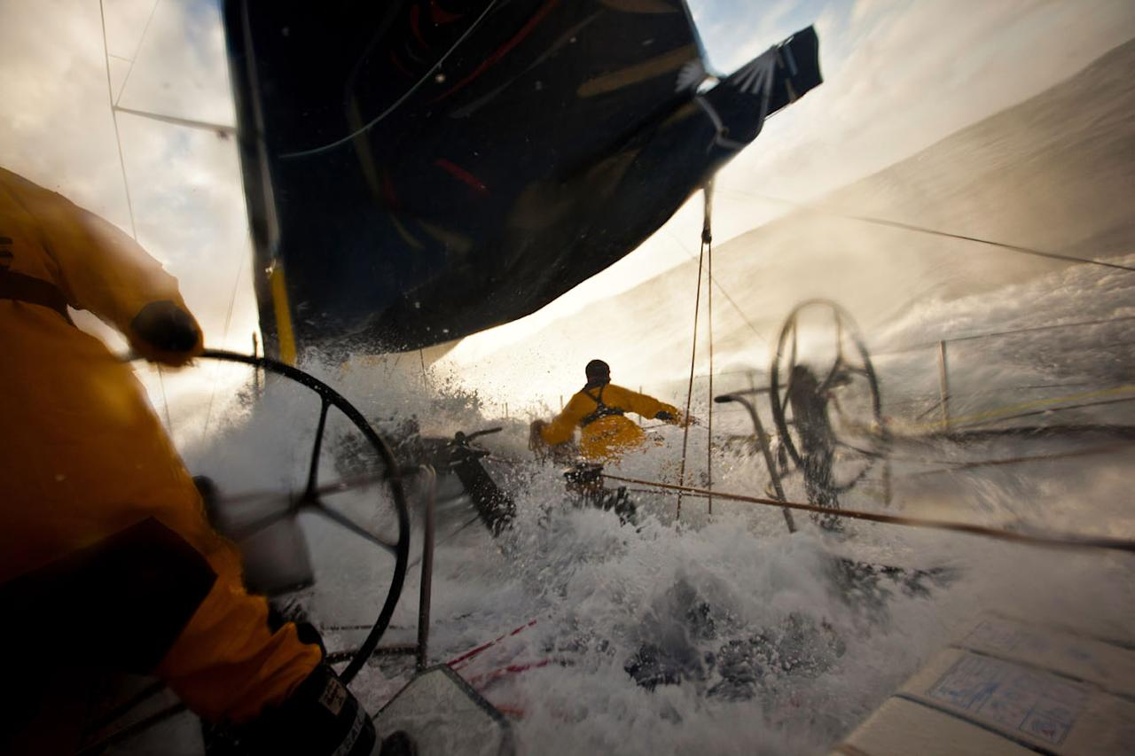 AT SEA - JUNE 14: Wade Morgan from Australia eases the Fractional Zero sail, as a 50 knot gust hits Abu Dhabi Ocean Racing, during leg 8 of the Volvo Ocean Race 2011-12 from Lisbon, Portugal to Lorient, France on June 13, 2012 at sea. (Photo by Amory Ross/PUMA Ocean Racing/Volvo Ocean Race via Getty Images)