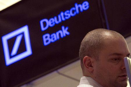 A Deutsche Bank sign is seen on the floor of the New York Stock Exchange January 15, 2014.   REUTERS/Brendan McDermid (UNITED STATES - Tags: BUSINESS) - RTX17FML