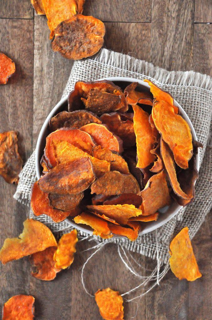 "<strong>Get the <a href=""http://minimalistbaker.com/baked-sweet-potato-chips/"" rel=""nofollow noopener"" target=""_blank"" data-ylk=""slk:Baked Sweet Potato Chips recipe"" class=""link rapid-noclick-resp"">Baked Sweet Potato Chips recipe</a>&nbsp;from Minimalist Baker</strong>"