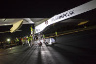 Crew members of Solar Impulse project check the HB-SIA experimental aircraft before taking off at Barajas airport in Madrid, Spain, Tuesday, June 5, 2012. The solar-powered airplane arrived in Madrid on May 25, 2012 from Payerne, Switzerland, and now goes on to Rabat, Morocco on its first transcontinental trip. The mission is described as the final dress rehearsal for a round-the-world flight with a new and improved aircraft in 2014.(AP Photo/Alberto Di Lolli)