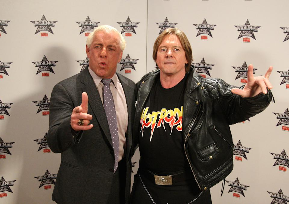 """Wrestlers Ric """"Nature Boy"""" Flair and """"Rowdy"""" Roddy Piper attend the WrestleMania 25th anniversary press conference at the Hard Rock Cafe on March 31, 2009 in New York City. (Photo by Jason Kempin/WireImage)"""