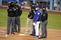 Los Angeles Dodgers manager Dave Roberts, second from right, and San Diego Padres manager Jayce Tingler, center, stand at home plate with the umpire crew before a baseball game Thursday, April 22, 2021, in Los Angeles. (AP Photo/Marcio Jose Sanchez)