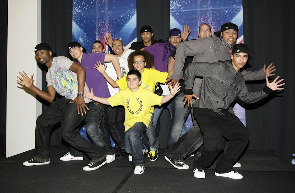 Diversity', the winners of Britain's Got Talent, (left to right, back row) Ike Ezekwugo, Sam Craske, Jamie McNaughton, Ian McNaughton, Mitchell Craske, Ashley Banjo, Warren Russell, Terry Smith, Jordan Banjo and Matthew McNaughton, (centre, front) Mitchell Craske and Perri Kiely (centre) during a press conference at Sony HQ in Kensington, west London.   (Photo by Yui Mok - PA Images/PA Images via Getty Images)