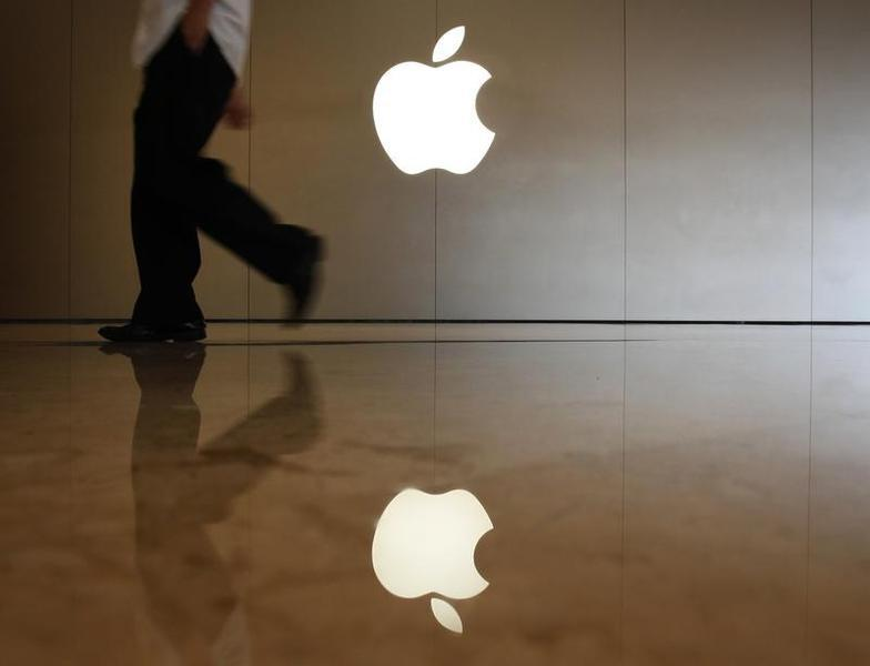 A man walks past the logo at an Apple store in Shenzhen