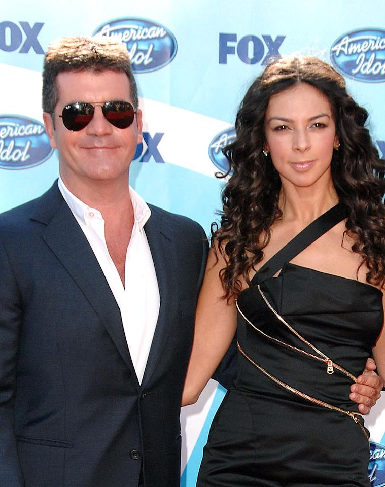 """Simon Cowell's ex-girlfriend Terri Seymour (also seen here at Wednesday's """"Idol"""" finale) was attacked following Tuesday's show. Janice Thibodeaux was arrested and charged with battery after confronting Seymour and putting her in a headlock. Thibodeaux told RadarOnline that she """"wasn't cool with"""" Cowell playfully choking fellow judge Paula Abdul on last week's show, so she went after Seymour in the same fashion. Steve Granitz/<a href=""""http://www.wireimage.com"""" target=""""new"""">WireImage.com</a> - May 20, 2009"""