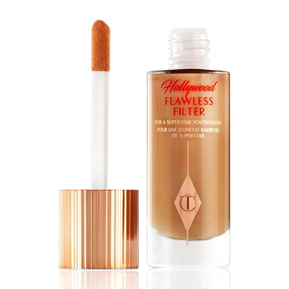 """<p><a href=""""https://www.allure.com/story/charlotte-tilbury-hollywood-flawless-filter-like-facetune-in-a-bottle?mbid=synd_yahoo_rss"""" rel=""""nofollow noopener"""" target=""""_blank"""" data-ylk=""""slk:Hollywood Flawless Filter"""" class=""""link rapid-noclick-resp"""">Hollywood Flawless Filter</a> does a little bit of everything — it acts as a tinted primer, radiance-boosting add-in to your foundation, or a highlighter, so you can fully customize your glow. The <a href=""""https://www.allure.com/story/what-is-glycerin-skin-care-ingredient?mbid=synd_yahoo_rss"""" rel=""""nofollow noopener"""" target=""""_blank"""" data-ylk=""""slk:glycerin-"""" class=""""link rapid-noclick-resp"""">glycerin-</a> and <a href=""""https://www.allure.com/story/squalane-vs-squalene-skin-care-difference?mbid=synd_yahoo_rss"""" rel=""""nofollow noopener"""" target=""""_blank"""" data-ylk=""""slk:squalane-spiked"""" class=""""link rapid-noclick-resp"""">squalane-spiked</a> fluid also contains fine-line-blurring powders for a soft-focus finish, as well as brightening porcelain flower to amp up your natural complexion. </p> <p>Best of all, the supersized doe-foot applicator makes it a breeze to apply exactly where you want it, and you can simply use your clean fingers (if you want to skip the brush) to blend it in. Charlotte Tilbury herself called it a """"<a href=""""https://www.allure.com/story/charlotte-tilbury-hollywood-flawless-filter-like-facetune-in-a-bottle?mbid=synd_yahoo_rss"""" rel=""""nofollow noopener"""" target=""""_blank"""" data-ylk=""""slk:complexion booster"""" class=""""link rapid-noclick-resp"""">complexion booster</a>,"""" so it's no surprise to me that <a href=""""https://www.tiktok.com/@officialsavannahrae/video/6917745116320926981"""" rel=""""nofollow noopener"""" target=""""_blank"""" data-ylk=""""slk:beauty TikTok"""" class=""""link rapid-noclick-resp"""">beauty TikTok</a> can't get enough of it. Gen Z loves to <em>dew</em> it up.</p>"""