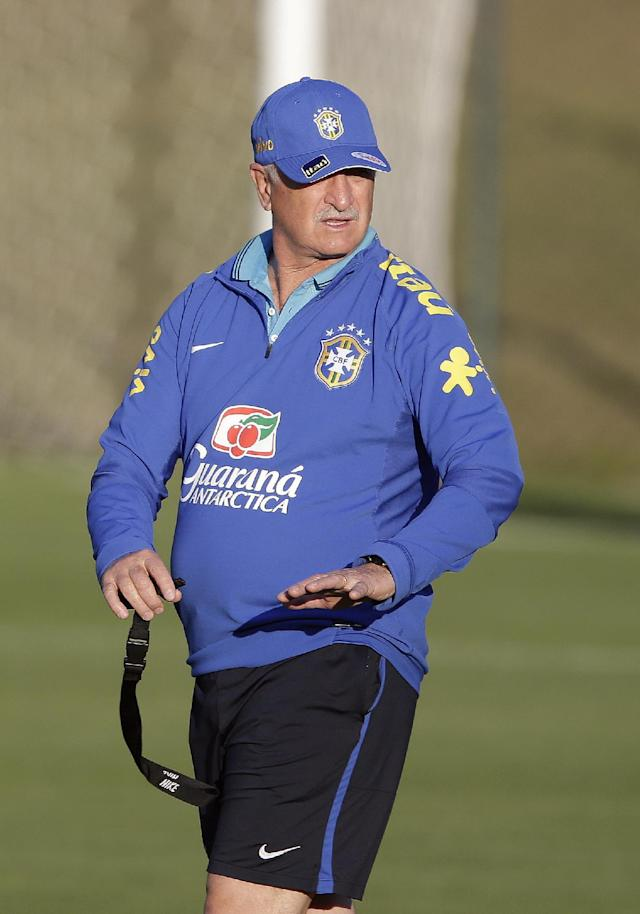 Brazil's national soccer team head coach Luiz felipe Scolari directs a practice session at the Granja Comary training center in Teresopolis, Brazil, Sunday, June 8, 2014. Brazil play in group A of the 2014 soccer World Cup. (AP Photo/Andre Penner)