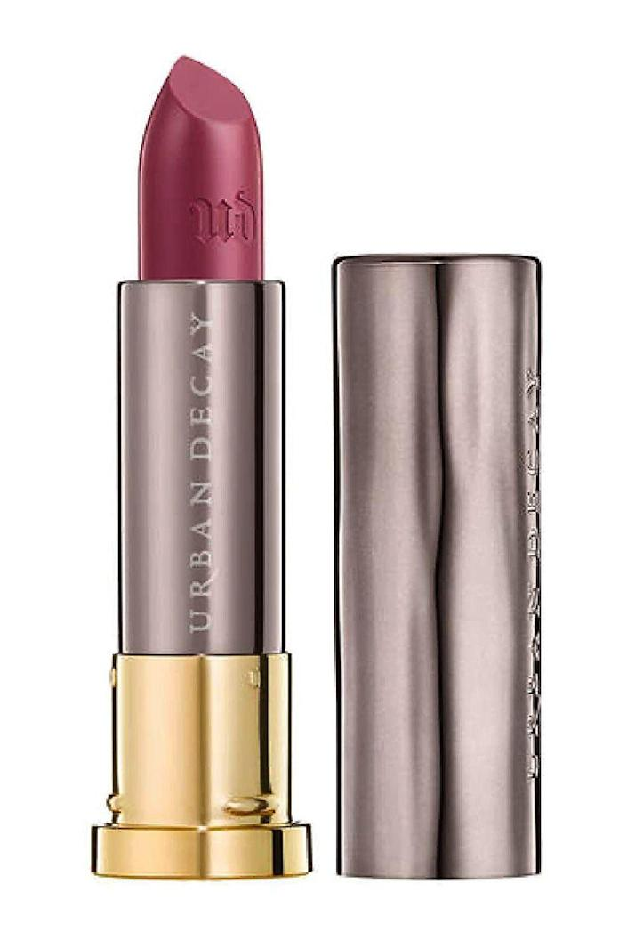 """<p><strong>Urban Decay</strong></p><p>macys.com</p><p><strong>$11.40</strong></p><p><a href=""""https://go.redirectingat.com?id=74968X1596630&url=https%3A%2F%2Fwww.macys.com%2Fshop%2Fproduct%2Furban-decay-vice-long-lasting-lipstick%3FID%3D2841086&sref=https%3A%2F%2Fwww.cosmopolitan.com%2Fstyle-beauty%2Fbeauty%2Fg35618102%2Fbest-beauty-products-under-twenty-dollars-cosmo-klarna-hauliday-2021%2F"""" rel=""""nofollow noopener"""" target=""""_blank"""" data-ylk=""""slk:Shop Now"""" class=""""link rapid-noclick-resp"""">Shop Now</a></p><p>When it comes to lipstick these days, the words """"long lasting"""" are pretty much the best promise a brand can make. Like, I need my lipstick to stay bright all day long, especially on the days when I have back-to-back-to-back Zoom calls. This formula delivers on that promise and more—it's even <strong>packed with <a href=""""https://www.cosmopolitan.com/style-beauty/beauty/a34221629/jojoba-oil-for-hair/"""" rel=""""nofollow noopener"""" target=""""_blank"""" data-ylk=""""slk:jojoba oil"""" class=""""link rapid-noclick-resp"""">jojoba oil</a> and aloe vera for extra moisture.</strong></p><p><strong>✨ PROMOTION:</strong> 30-40% off select items at Macys.com, no promo code needed</p>"""