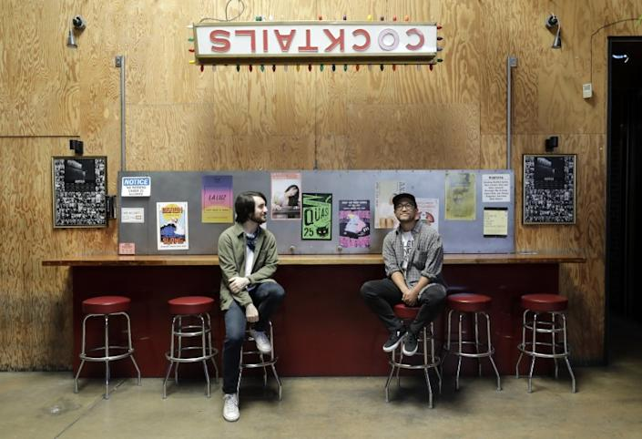 """Kyle Wilkerson, left, and marketing director Tommy Sugimoto at the closed Bootleg Theater in Los Angeles. Without government funding, they may never reopen. <span class=""""copyright"""">(Myung J. Chun/Los Angeles Times)</span>"""