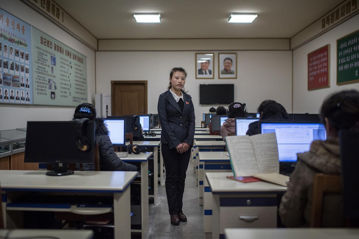 Ri Yong-Hwa, 23, poses for a portrait in a classroom at the Kim Jong-Suk silk mill in Pyongyang. A regular fixture on the itineraries of foreign journalists and tourists, the Kim Jong-Suk textile mill is named after the grandmother of current North Korean leader Kim Jong-Un.