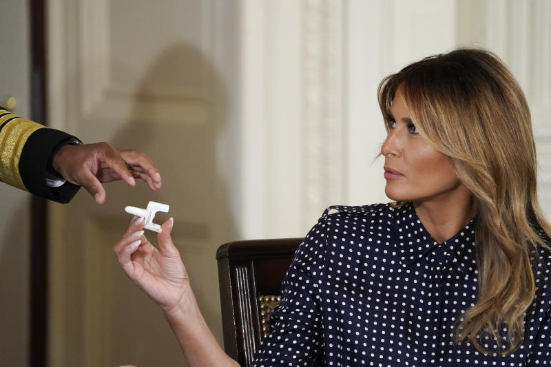 WASHINGTON, DC - SEPTEMBER 03: U.S. Surgeon General Jerome Adams shows First Lady Melania Trump a Naloxone nasal spray, which helps reverse opioid overdoses, during an event to mark National Alcohol and Drug Addiction Recovery Month in the East Room of the White House on September 3, 2020 in Washington, DC. The First Lady hosted a round table event with people who are recovering from substance use and mental health issues. (Photo by Drew Angerer/Getty Images)